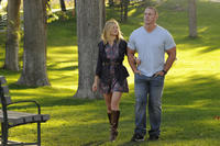 Amy Smart as Nina and John Cena as Sam Cleary in ``The Reunion.''