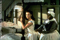 Vivien Leigh as Scarlett O'Hara and Hattie McDaniel as Mammy in ``Gone with the Wind.''