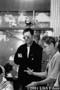 Director Wong Kar-wai discusses a scene with co-cinematographer Christopher Doyle on the set of the film.