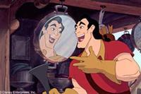 Gaston, the handsome village heartthrob and all-around macho man, admires himself in the mirror while singing about his desire to woo and marry Belle, in this musical moment.