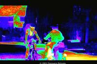 Thermal image of a bike rider and a motorcyclist in