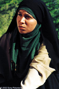 Nassim Abdi as the girl in