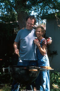 Jennifer Aniston as Justine and John C. Reilly as her husband, Phil, in