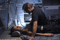 Chris Kelvin (George Clooney) ponders the shocking appearance of his beloved wife Rheya (Natascha McElhone) aboard a space station.