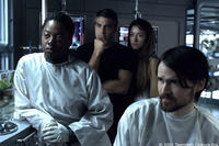 Snow (Jeremy Davies), Rheya (Natascha McElhone), Kelvin (George Clooney) and Gordon (Viola Davis) confront the mysteries aboard a space station orbiting a mysterious planet.