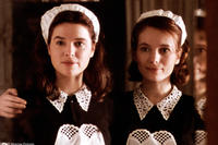 Lotte (Thekla Reuten) and her twin sister Anna (Nadja Uhl) work as maids at the Falkenau dinner party in Miramax Films' TWIN SISTERS. Courtesy: Miramax Films