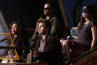Gina Torres as Zoe, Nathan Fillion as Captain Malcolm Reynolds, Adam Baldwin as Jayne and Summer Glau as River in