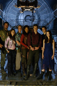 Adam Baldwin as Jayne, Jewel Staite as Kaylee, Alan Tudyk as Wash, Gina Torres as Zoe, Nathan Fillion as Captain Malcolm Reynolds, Sean Maher as Simon and Summer Glau as River in