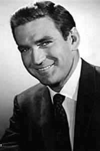 Rod Taylor as Mitch Brenner in