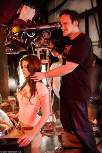 Director Quentin Tarantino and Vanessa Ferlito on the set of