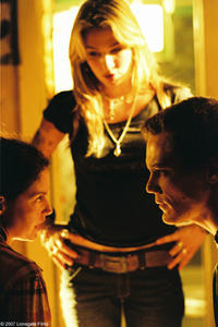 Agnes White (Ashley Judd), R.C. (Lynn Collins) and Peter Evans (Michael Shannon) in