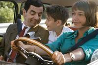 Rowan Atkinson, Max Baldry and Emma de Caunes in