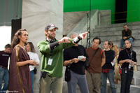 Director Zack Snyder blocks a scene with Lena Headey on the set of the film