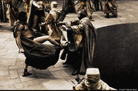 Leonidas (Gerard Butler) personally delivers his answer to the Persian Messenger (Peter Mensah) in