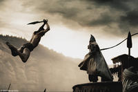 Stelios (Michael Fassbender) leaps over several guards to counter the attack of the Persian emissary (Tyrone Benskin) in
