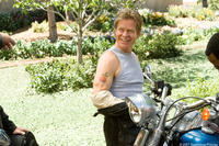 Dudley Frank (William H. Macy) shows off his new tattoo in