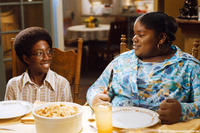 Nine-year-old Norbit (Austin Reid) and a 10-year-old Rasputia (Lindsey Sims-Lewis) share a meal in