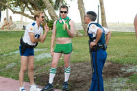 In Miami, Lt. Jim Dangle (Thomas Lennon) and Dep. Travis Junior (Robert Ben Garant) encounter an old