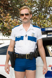 Lt. Jim Dangle (Thomas Lennon), sporting his trademark short-shorts in