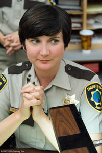 Dep. Trudy Wiegel (Kerri Kenney-Silver) listens attentively at the daily morning meeting of the Reno Sheriff's Dept. in