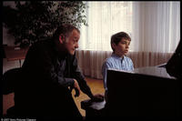 Vitus (Teo Gheorghiu) has a piano lesson in