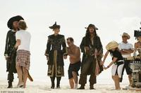 Geoffrey Rush, Keira Knightley and Johnny Depp on the set of
