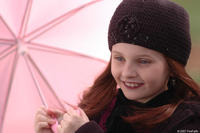 Despite the rain, Emily (Abigail Breslin) finds a reason to smile in