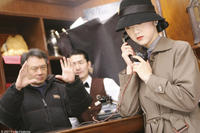 Director Ang Lee and Tang Wei on the set of