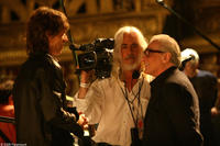 Mick Jagger, director of photography Robert Richardson, ASC and director Martin Scorsese on the set of