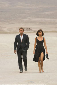 James Bond (Daniel Craig) and Camille (Olga Kurylenko) walk through the Bolivian desert in