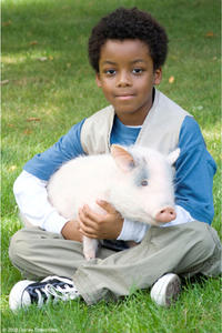 Eshaya Draper and Albert the Pig in