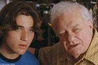 Trevor Morgan as John and Charles Durning as Yammi in