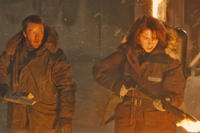 Joel Edgerton as Sam Carter and Mary Elizabeth Winstead as Kate Lloyd in ``The Thing.''