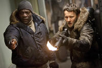 Adewale Akinnuoye-Agbaje as Jameson and Joel Edgerton as Braxton Carter in ``The Thing.''