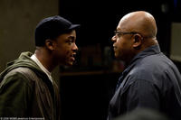 Collins Pennie as Malik and Charles S. Dutton as James Dowd in