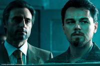 Mark Strong as Hani and Leonardo DiCaprio as Roger Ferris in