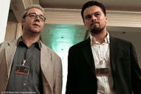 Russell Crowe as Ed Hoffman and Leonardo DiCaprio as Roger Ferris in