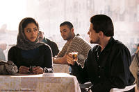 Golshifteh Farahani as Aisha and Leonardo DiCaprio as Roger Ferris in