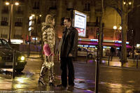 Fani Kolarova as the streetwalker and Liam Neeson as Bryan in