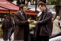 Olivier Rabourdin as Jean Claude and Liam Neeson as Bryan in