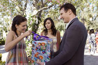 Maggie Grace as Kim, Famke Janssen as Lenore and Liam Neeson as Bryan in