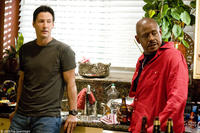 Keanu Reeves and Forest Whitaker in