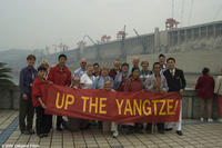 Film participants and tourists hold a banner at the Three Gorges Dam in UP THE YANGTZE, a film by Yung Chang, a Zeitgeist Films release. Photo: Yung Chang