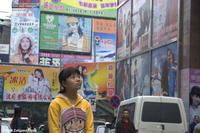 Yu Shui walks through the wholesale market in Chongqing City in UP THE YANGTZE, a film by Yung Chang, a Zeitgeist Films release. Photo: Yung Chang