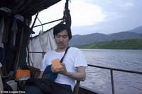 Director Yung Chang on a tributary of the Yangtze during the filming of UP THE YANGTZE, a film by Yung Chang, a Zeitgeist Films release.