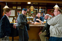 Christopher Carley as Father Janovich, Clint Eastwood as Walt Kowalski, Greg Trzaskoma as the bartender, Tom Majard as Mel and Davis Gloff as Darrell in