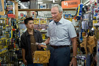 Bee Vang as Thao and Clint Eastwood as Walt Kowalski in