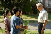 Brooke Chia Thao as Vu, Bee Vang as Thao, Ahney Her as Sue and Clint Eastwood as Walt Kowalski in