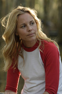 Maria Bello as May in