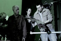 Ron Perlman and director Simon Hunter on the set of